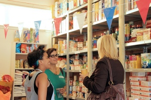 Volunteers and voucher partners chatting at our anniversary party last May
