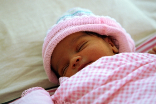 'Newborn in hospital' by World Bank Photo Collection (Creative Commons)